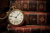 Old pocket watch and books in Low-key copy space — Stok fotoğraf