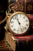Old pocket watch and books in Low-key — ストック写真
