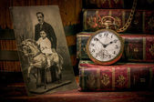 Grandfather photo, pocket watch and books in Low-key — 图库照片