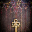 Golden Key on Ancestral Book Cover - Stock Photo