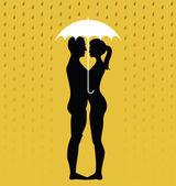 Silhouette of young couple under an umbrella — Stock Vector