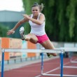 Professional female hurdler during training — Stock Photo #10963462