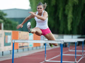 Professional female hurdler during training — Stock Photo