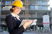 Female construction engineer / architect with a tablet computer — Stock Photo