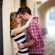 Young couple in love, hugging in the old part of town - 