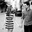 Young couple walking in the old part of town — Stock Photo #11338795