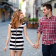 Young couple walking in the old part of town — Stok fotoğraf