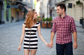 Young couple walking in the old part of town — Stock Photo