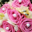 Stock Photo: Wedding bouquet and golden rings