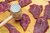 Raw beef meat on board — Stock Photo