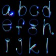 Handwritten neon light alphabets — Stock Photo #12129599