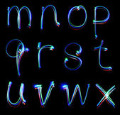 Handwritten neon light alphabets — Stock Photo