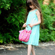 Portrait of little child girl checking her bag — Stock Photo #10810998