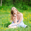 Outdoor portrait of beautiful young blond woman — Stock Photo