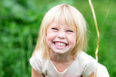 Happy child girl grinning — Stock Photo