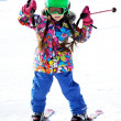 Royalty-Free Stock Photo: Portrait of little girl skier in sports suit