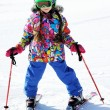 Portrait of little girl skier in sports suit — Stock Photo
