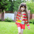 Portrait of cute little girl in red outfit — Stock Photo
