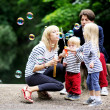 Happy family having fun together in park — Stock Photo #11481933