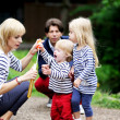 Happy family having fun together in the park — Stock Photo #11481937