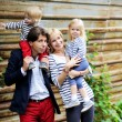 Happy parents with children posing outdoors — Stock fotografie