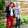 Happy parents with children posing outdoors — ストック写真