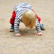 Baby boy trying to stand up — Stock Photo #11481964
