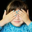Little girl with hands covering her eyes — Stock Photo #11593535