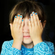 Little girl with hands covering her eyes — Stock Photo #11593539
