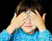 Little girl with hands covering her eyes — Stock Photo