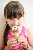 Cute little girl with ice cream in studio — Stock Photo