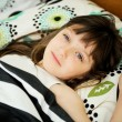 Portrait of awaken little girl in bed — Stock Photo