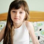 Portrait of awaken little girl sitting in bed — Stock Photo #11717883