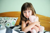 Portrait of awaken little girl sitting in bed — Stock Photo