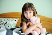 Portrait of awaken little girl sitting in bed — Stock Photo