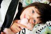 Portrait of awaken little girl in bed — Stock Photo
