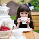 Elegant child girl having a tea party outdoors — Stock Photo #11854266