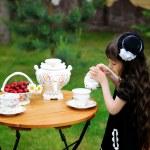 Elegant child girl having a tea party outdoors — Stock Photo #11854728