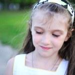 Outdoors portrait of little girl — Stock Photo #11945289