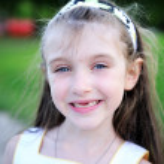 Outdoors portrait of little girl — Stock Photo #11945290