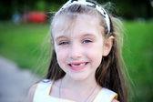 Outdoors portrait of little girl — Stock Photo