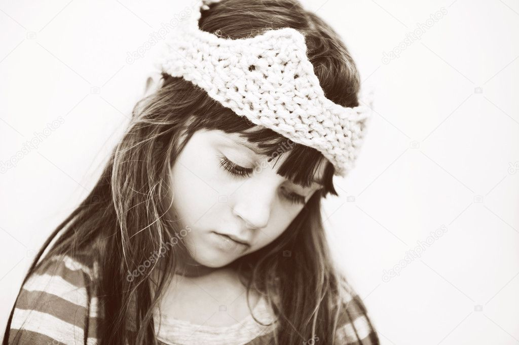 Closeup portrait of adorable smiling little girl wearing knitted crown, sepia tone — Stock Photo #11945298
