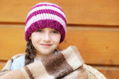 Adorable smiling little girl in cap and scarf — Stock Photo