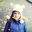 Portrait of cheerful child girl in white hat — Stock Photo