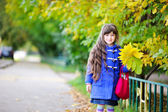 Portrait of a pretty child girl with yellow leaves — Stock Photo