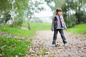 Autumn portrait of a child girl in warm jacket — Stock Photo