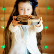 Little girl in anticipation of Christmas night — Stock Photo #12326032