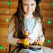 Little girl in anticipation of Christmas night — Stock Photo