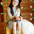 图库照片: Little girl in anticipation of Christmas night