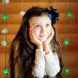 Стоковое фото: Little girl in anticipation of Christmas night